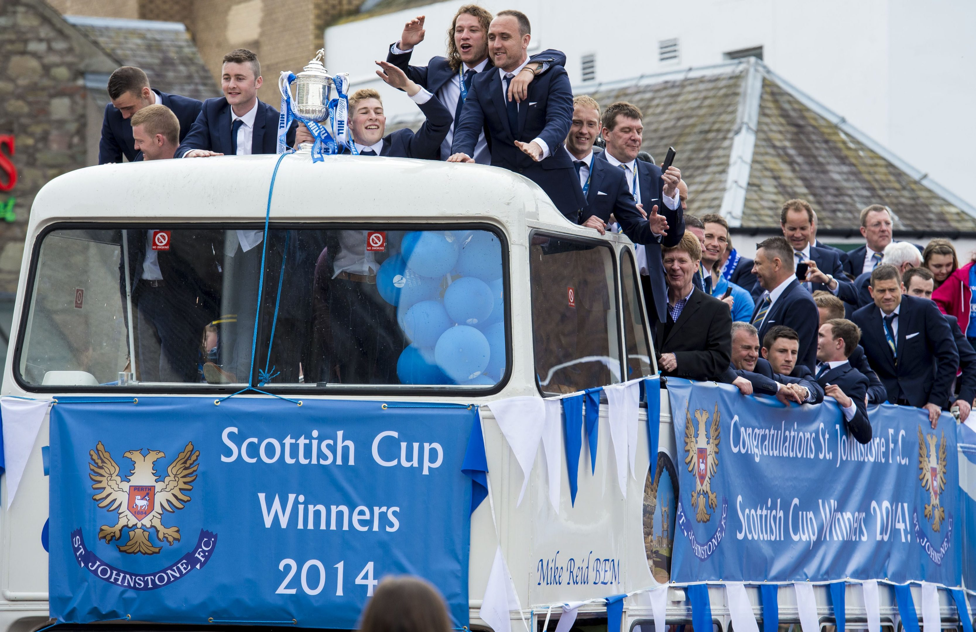 Jim can be spotted on the St Johnstone open-top bus in 2014.