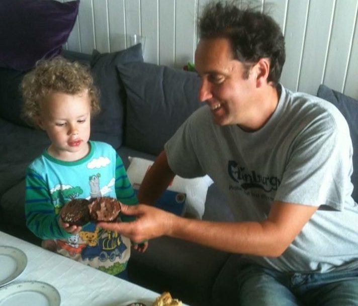 Brett feeding his son Leon in Norway