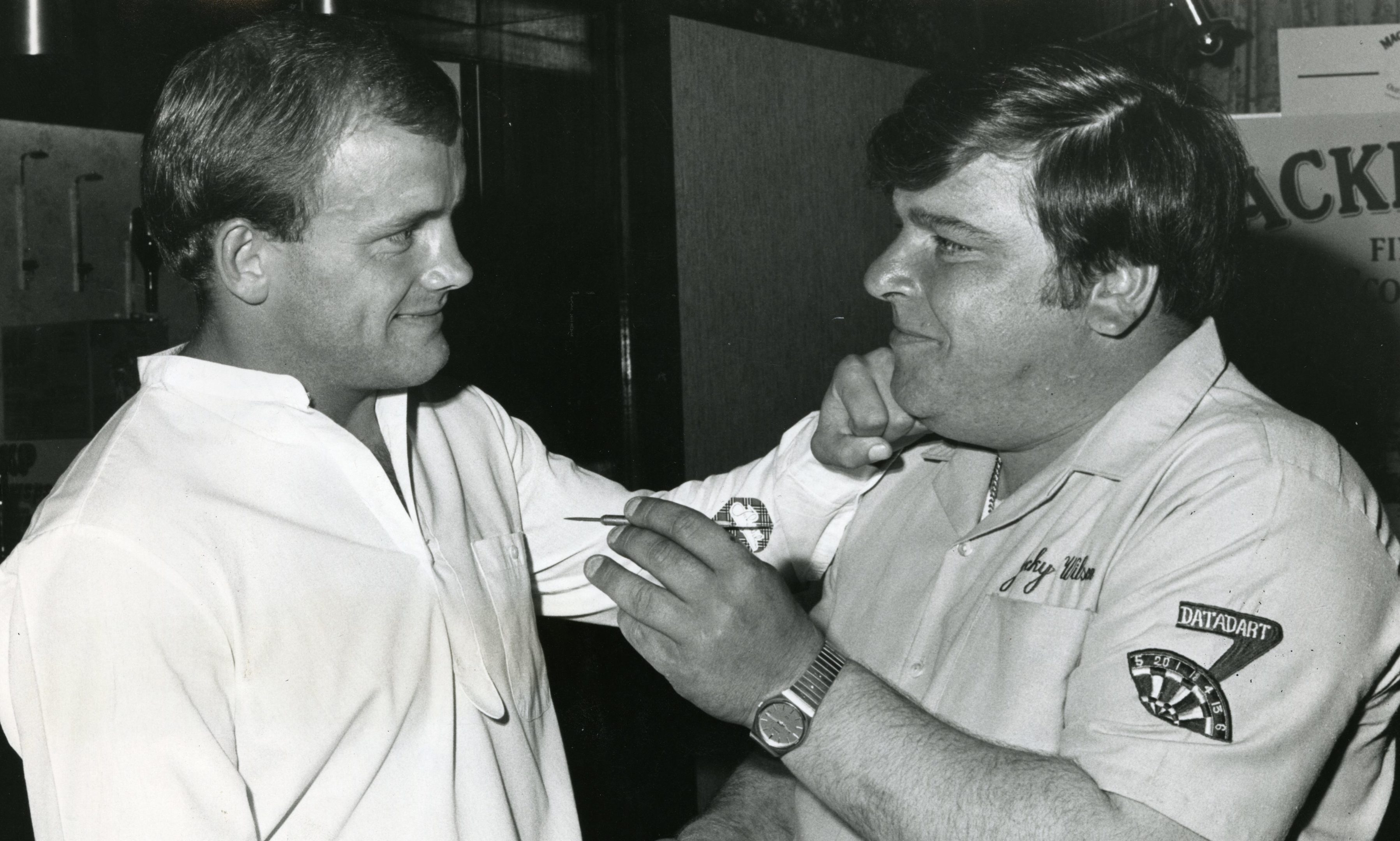 Jocky Wilson right) and George Kerr posing together at a charity darts exhibition held in the Angus Hotel in Dundee in 1984.