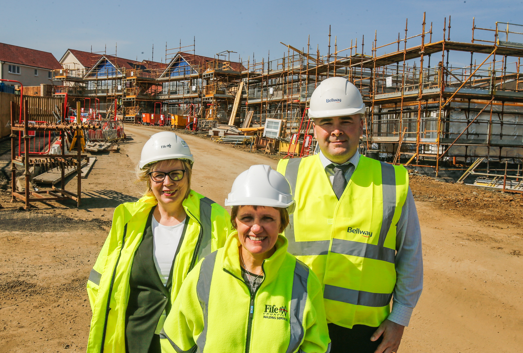 Councillor Judy Hamilton (front) with Louise Sutherland from Fife Council and David Leaf from Bellway Homes Scotland at the site of an affordable housing development in Cowdenbeath.