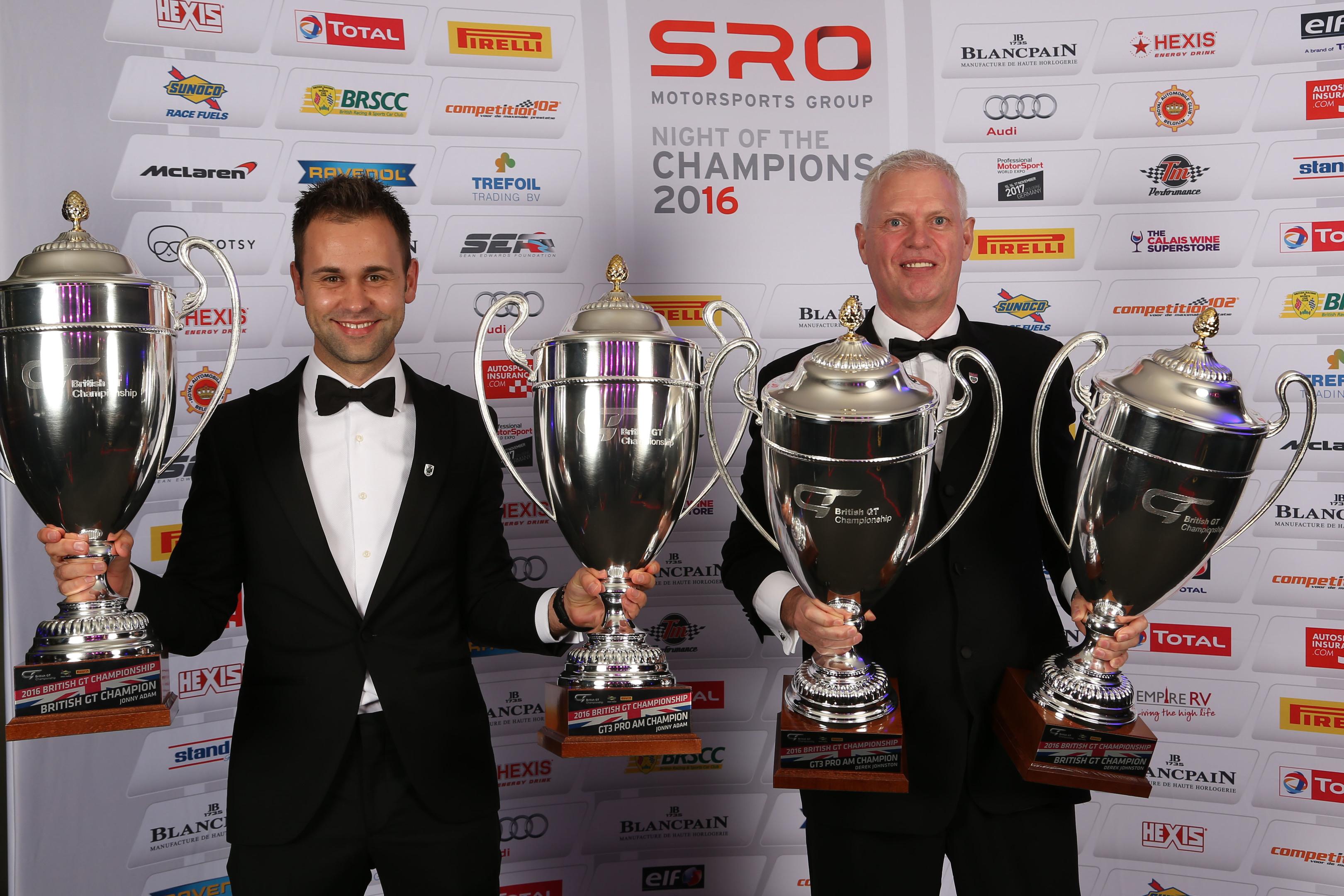 Jonny Adam and TF Sport teammate Derek Johnston with the 2016 British GT silverware