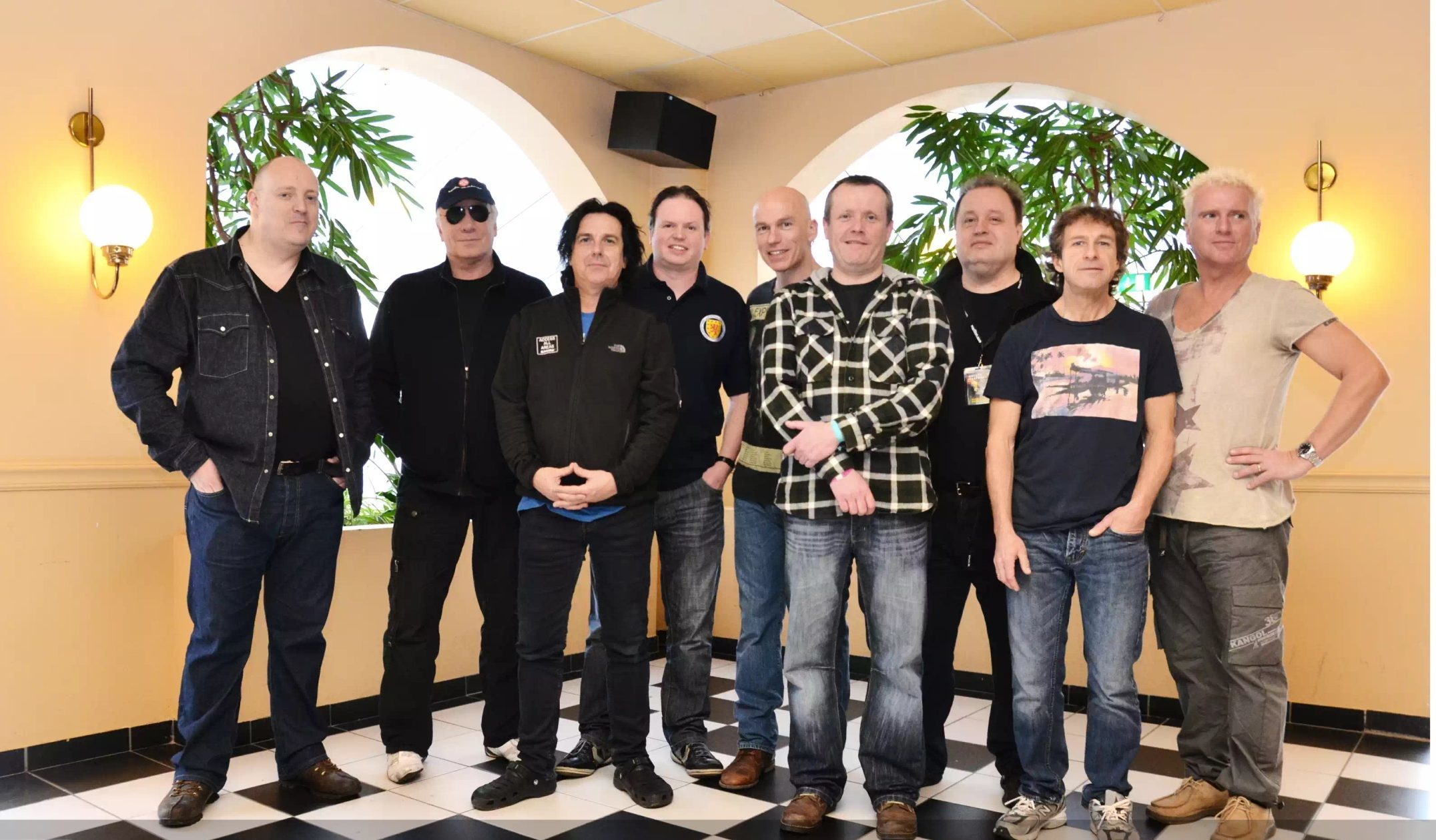 Kevin O'Neil, left, and friends met members of Marillion three years ago.