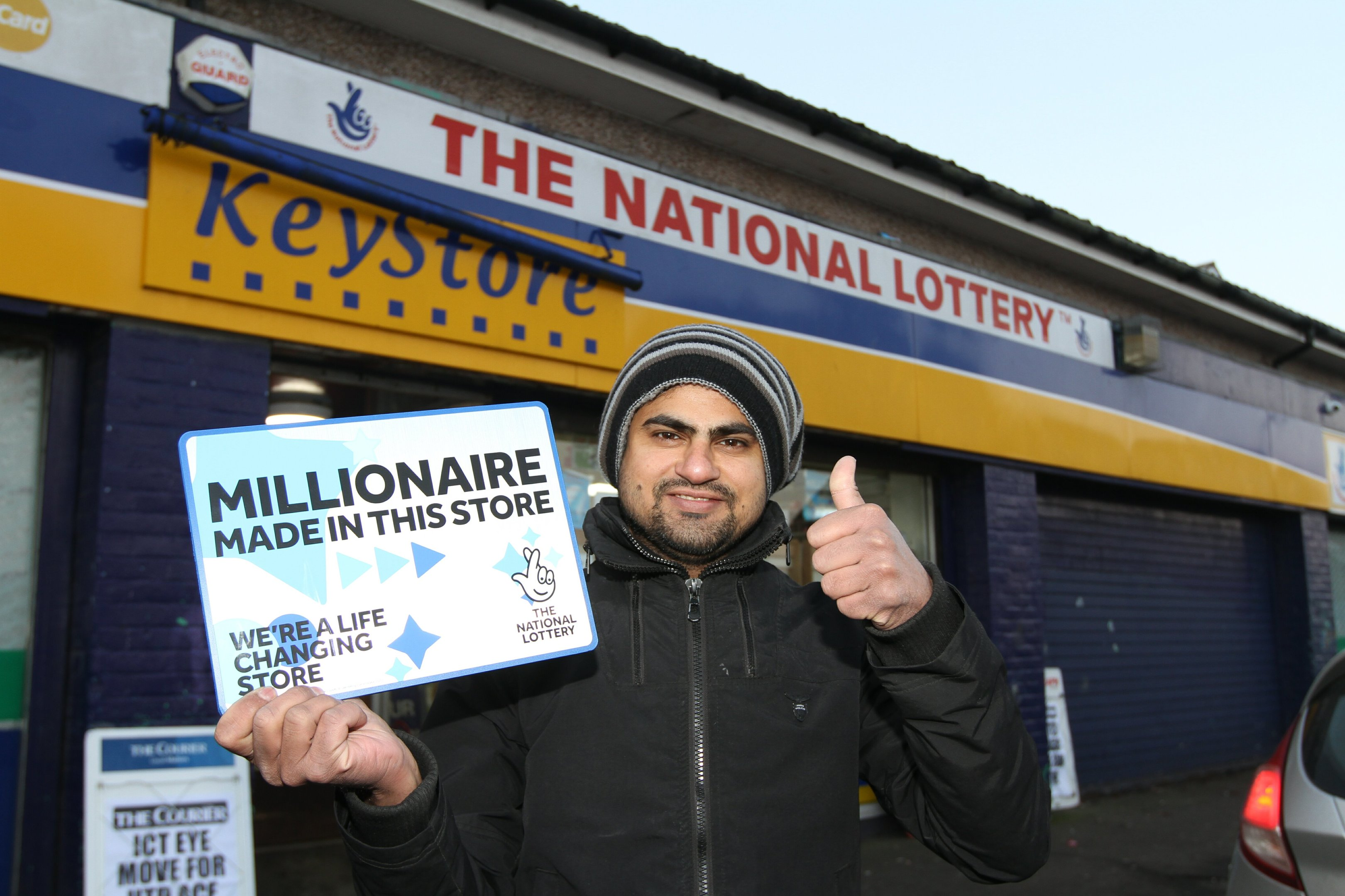 Nasim with the sign on display in his shop.
