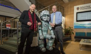 Artist David Marr visited his own Oor Wuillie in the reception at Abertay University with Principal Nigel Seaton.