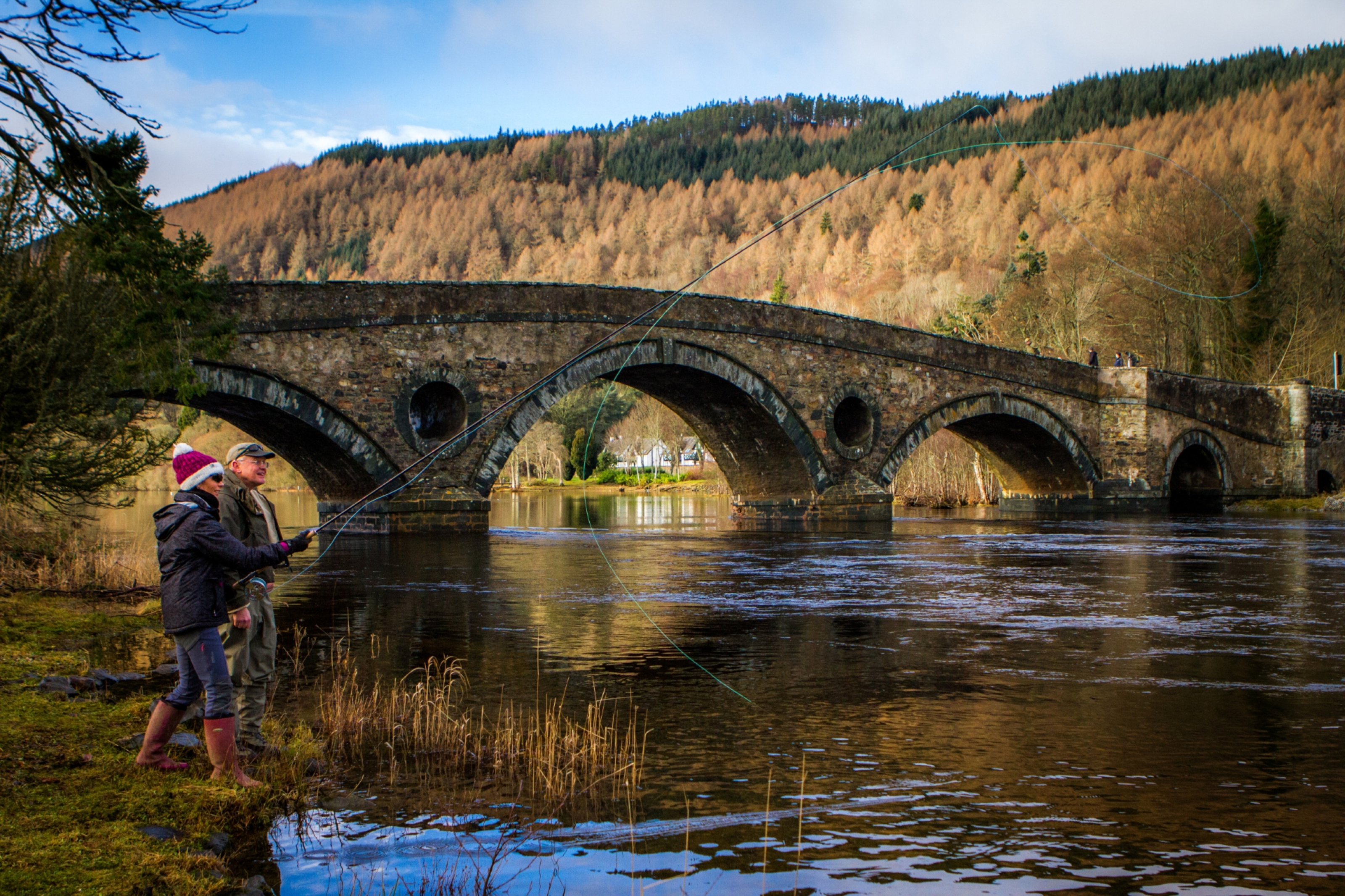 Mark Bowler showing Gayle Ritchie how to fly fish on the River Tay at Kenmore.