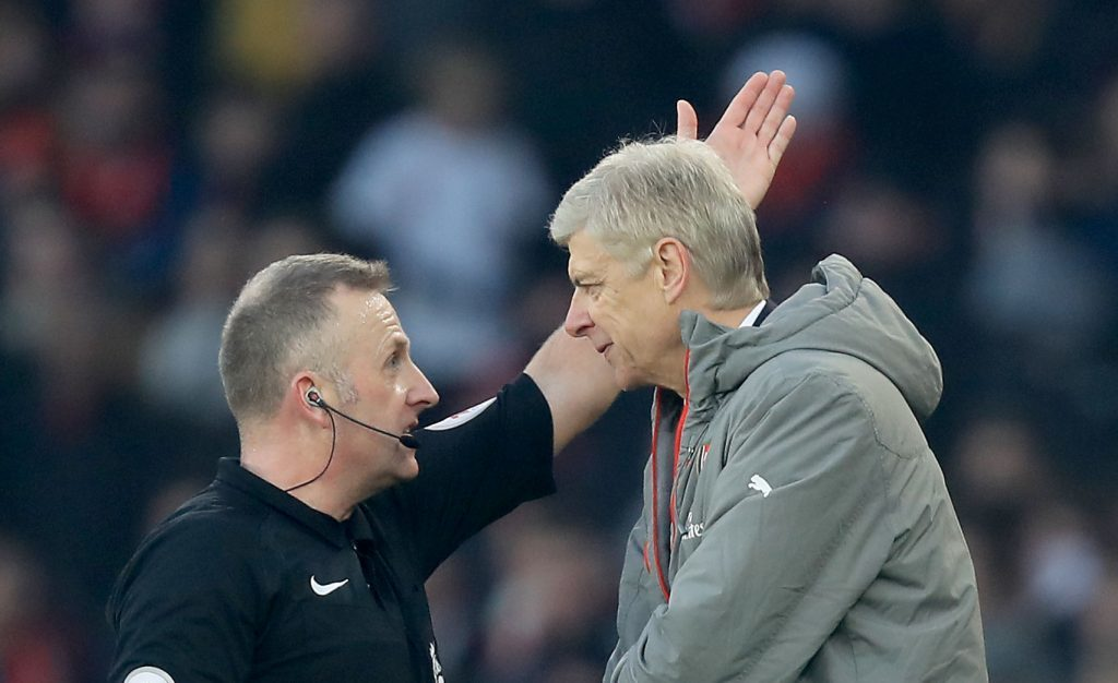 Referee Jonathan Moss has had enough of listening to Arsene Wenger.