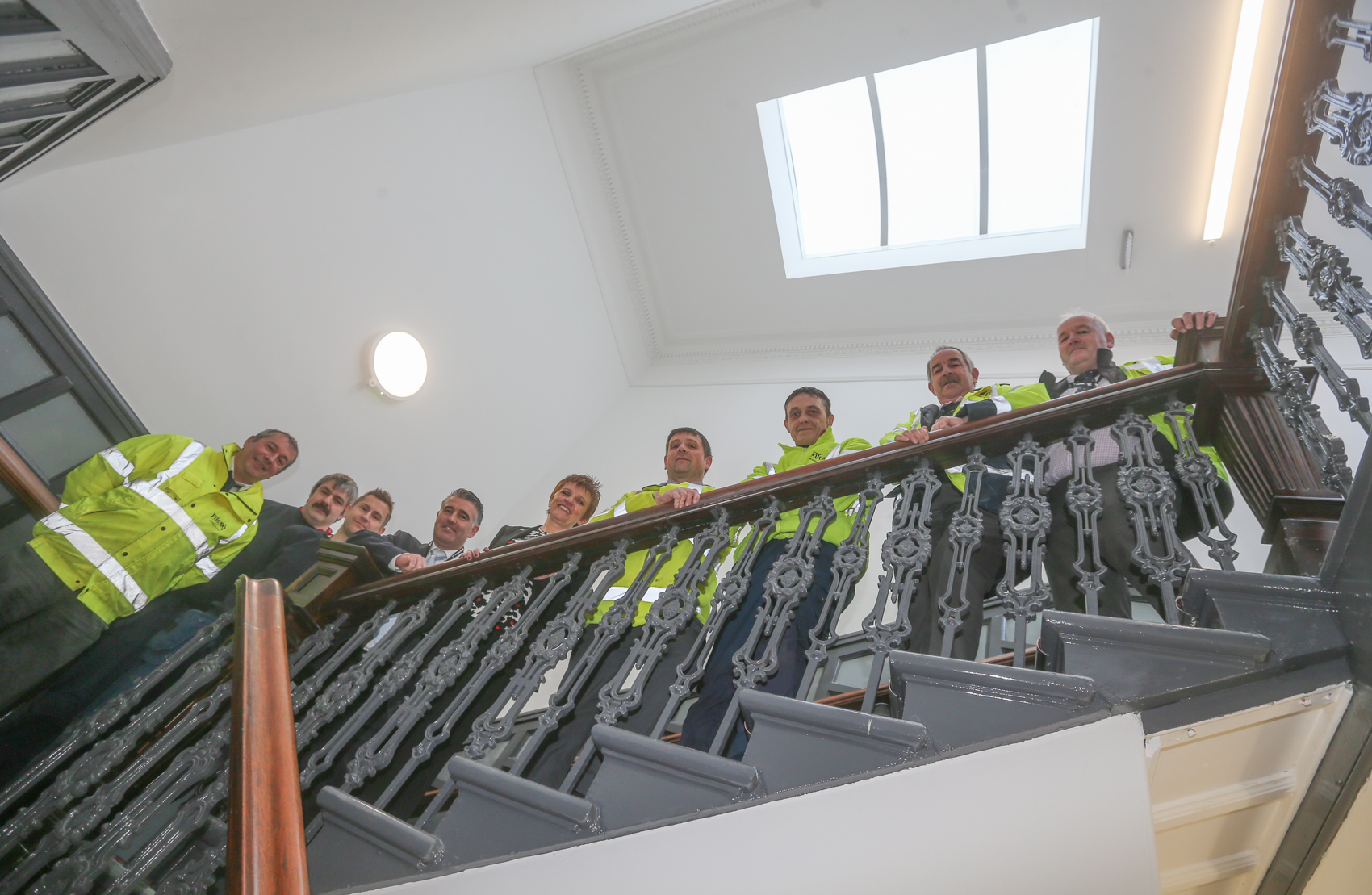 The council team on the staircase of the restored Town House