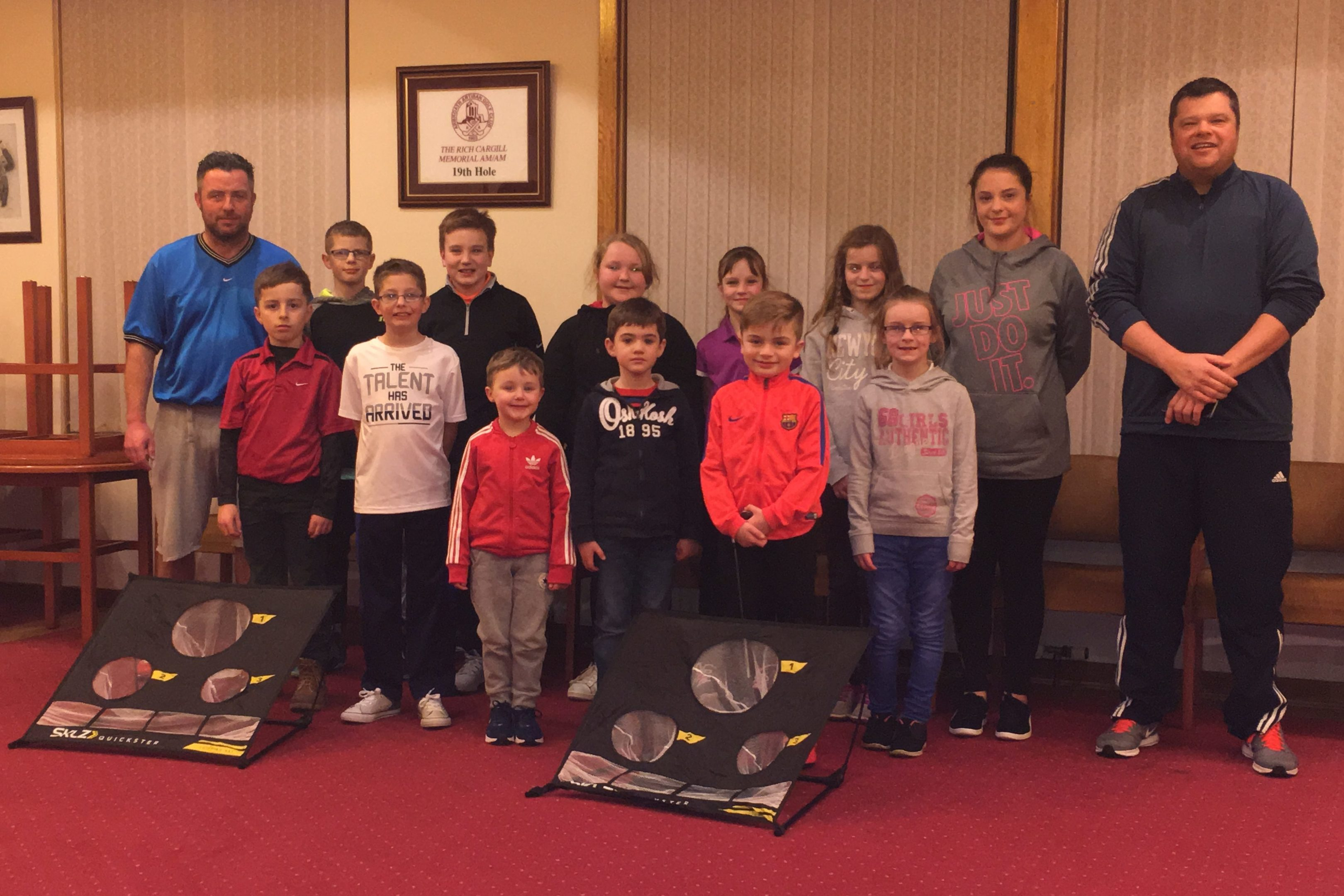 Coaches Jonathan Mullet and Paul Teviotdale with some of the youngsters at their Friday night club.