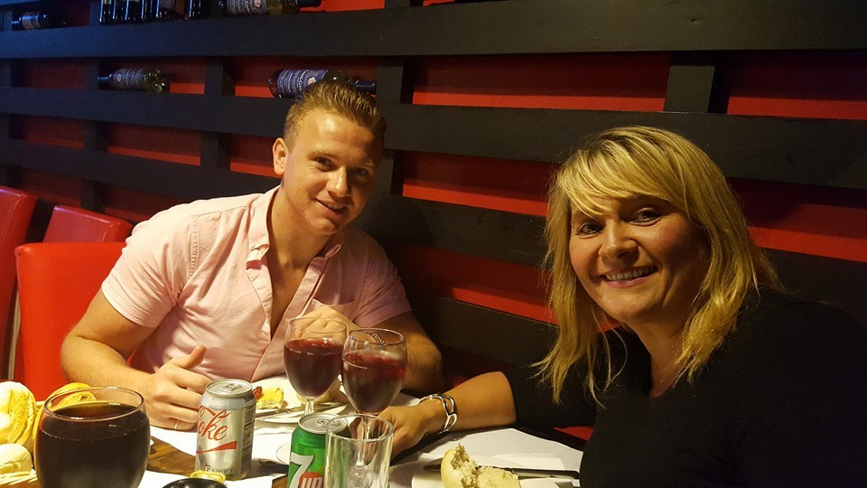 Corrie pictured with his mum Nicola.