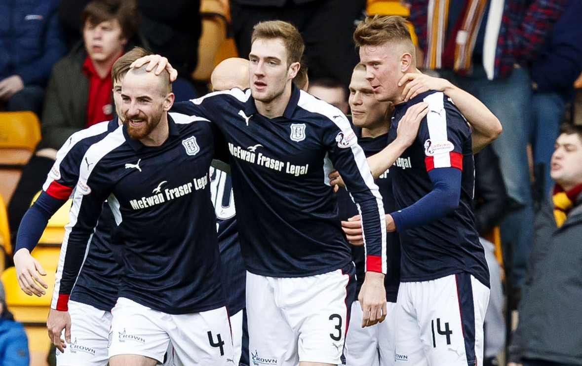 The Dundee players celebrate one of their five first half goals at Motherwell.