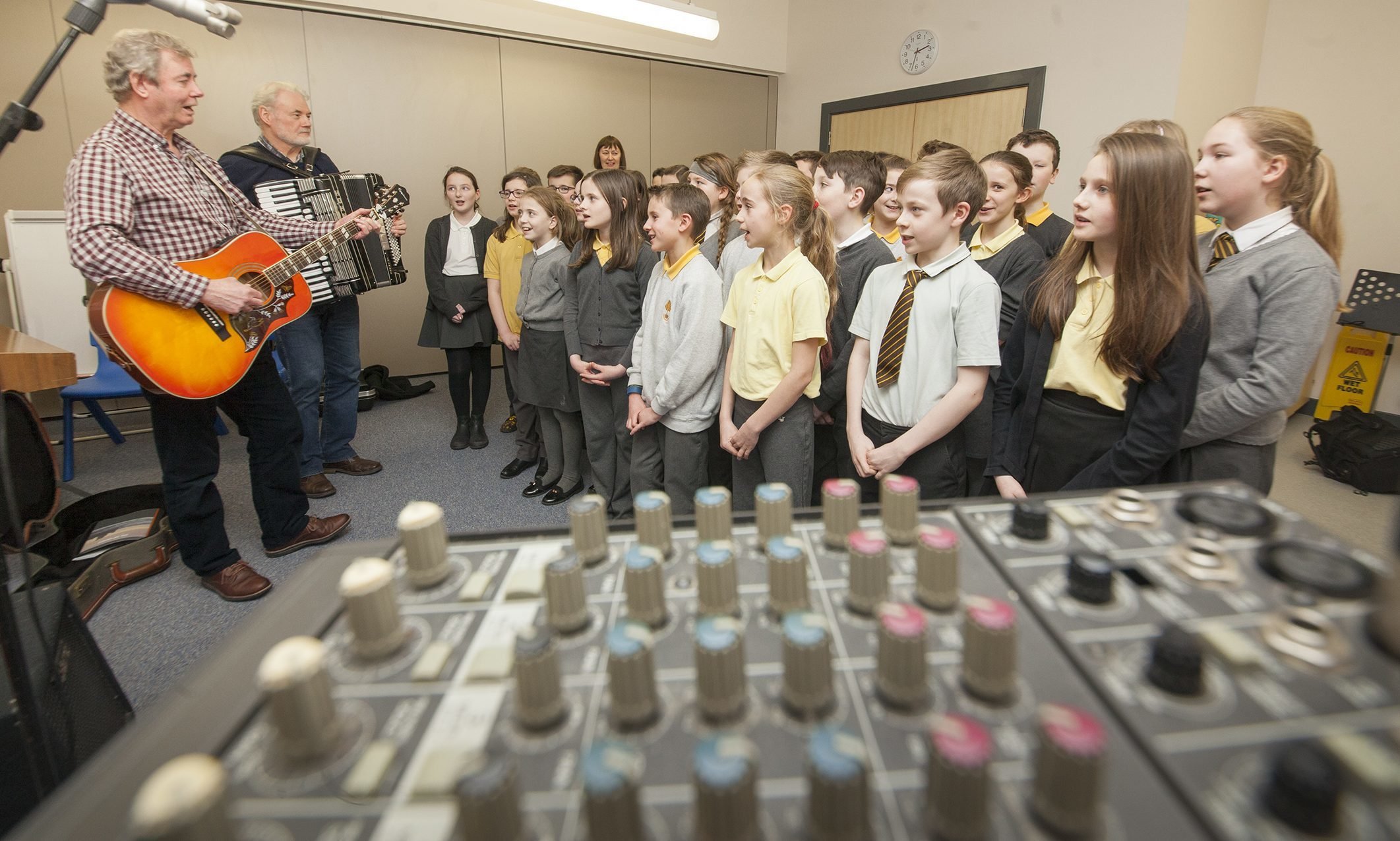Ian Lamb and Tony Simpson leading the recording with pupils.