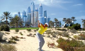 Sergio Garcia visits the desert on his way to winning the Dubai Desert Classic, in his Sunday yellow shirt.