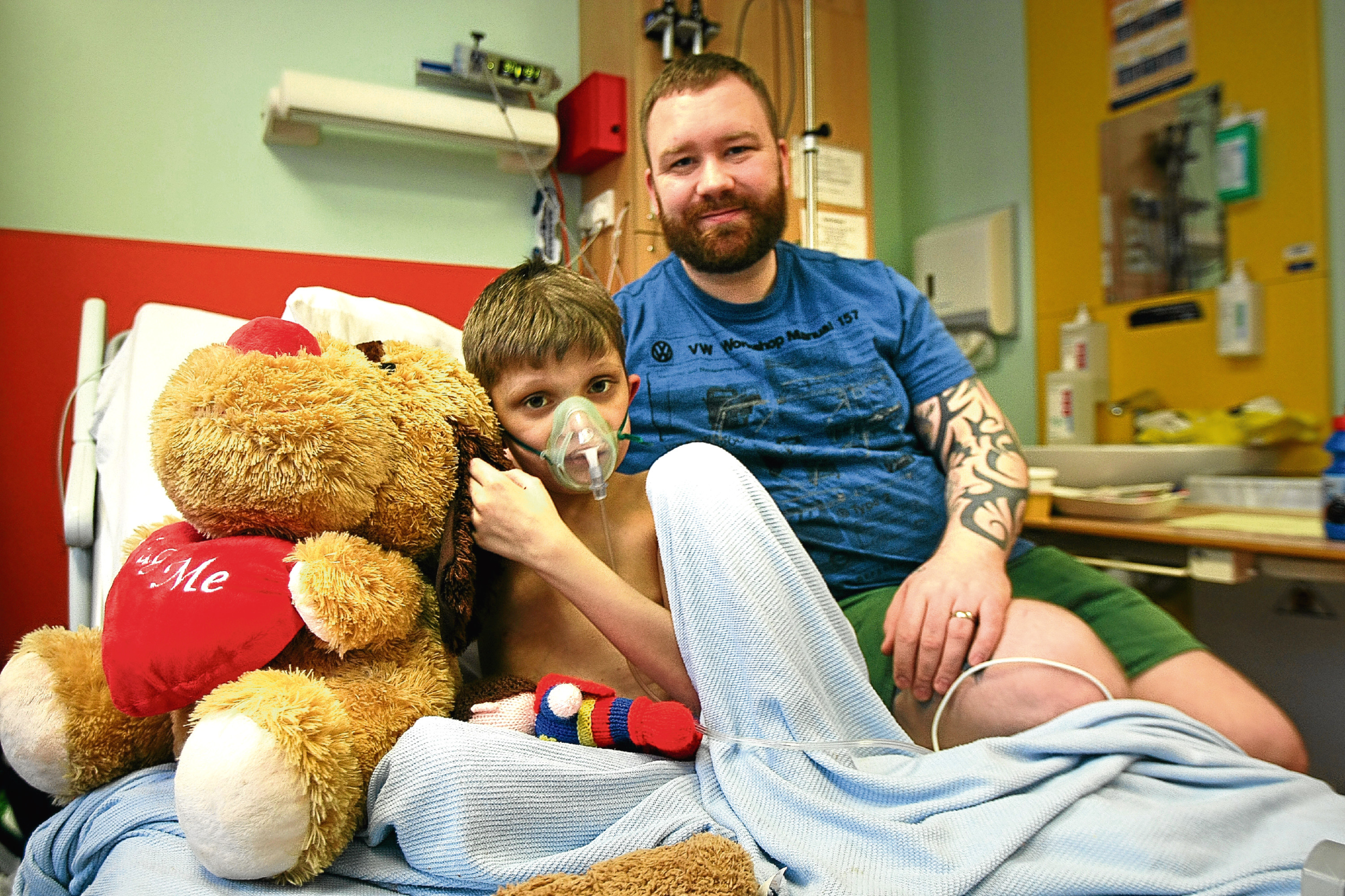 Local boy Kenzy Oliver, who has just had a liver transplant, with his dad Nicky at Ninewells Hospital. The Scottish Government is looking at how to increase organ donation.