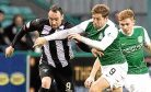 Dunfermline's Michael Moffat and Hibernian's Grant Holt.