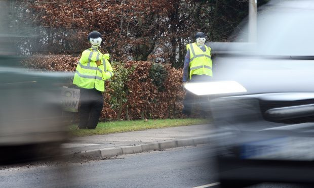 Scarecrow police installed at the roadside in Coupar Angus.
