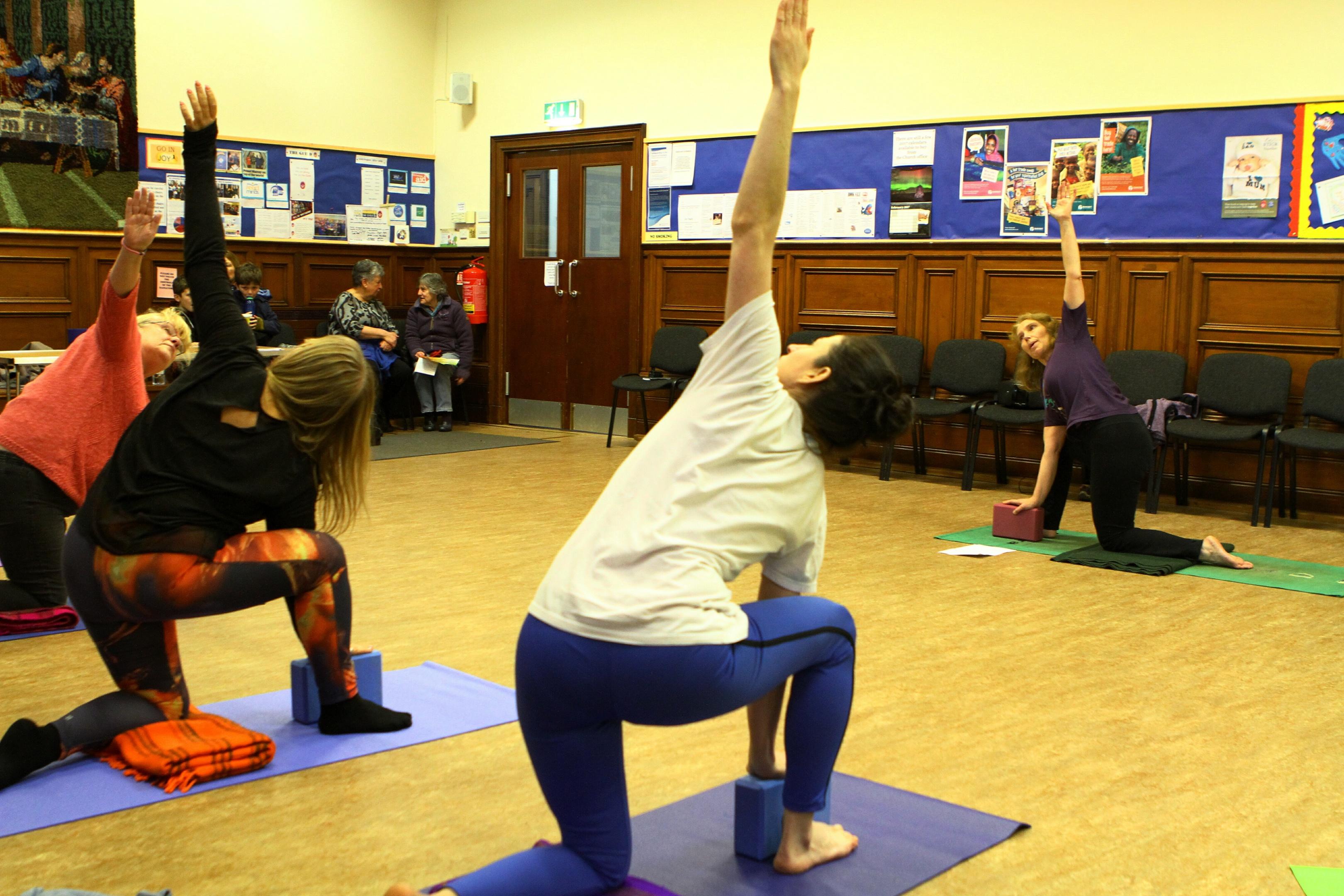 Elizabeth Pawley leading a yoga class in the Old Parish Church hall.
