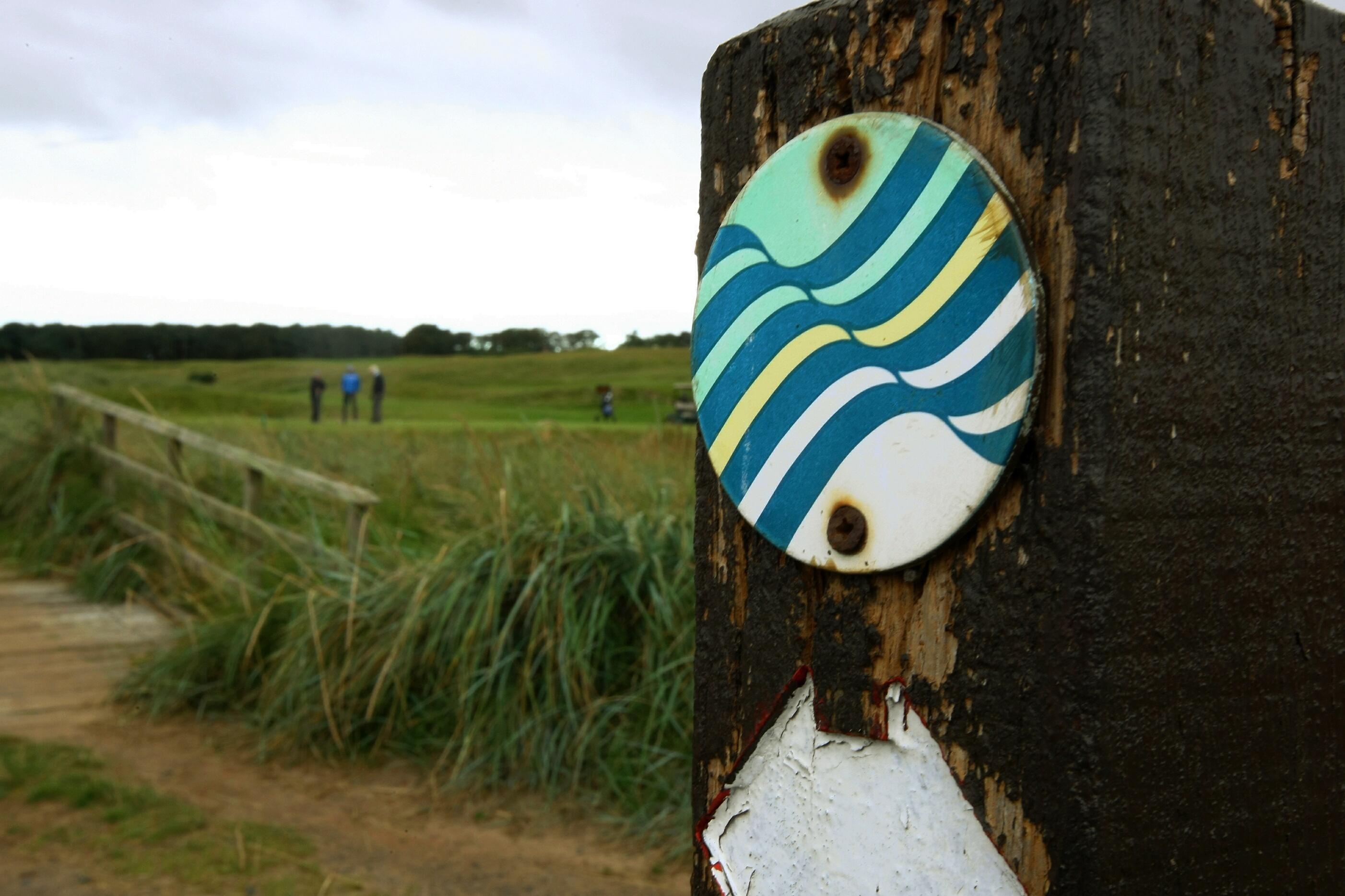 The coastal path runs right beside the golf course.