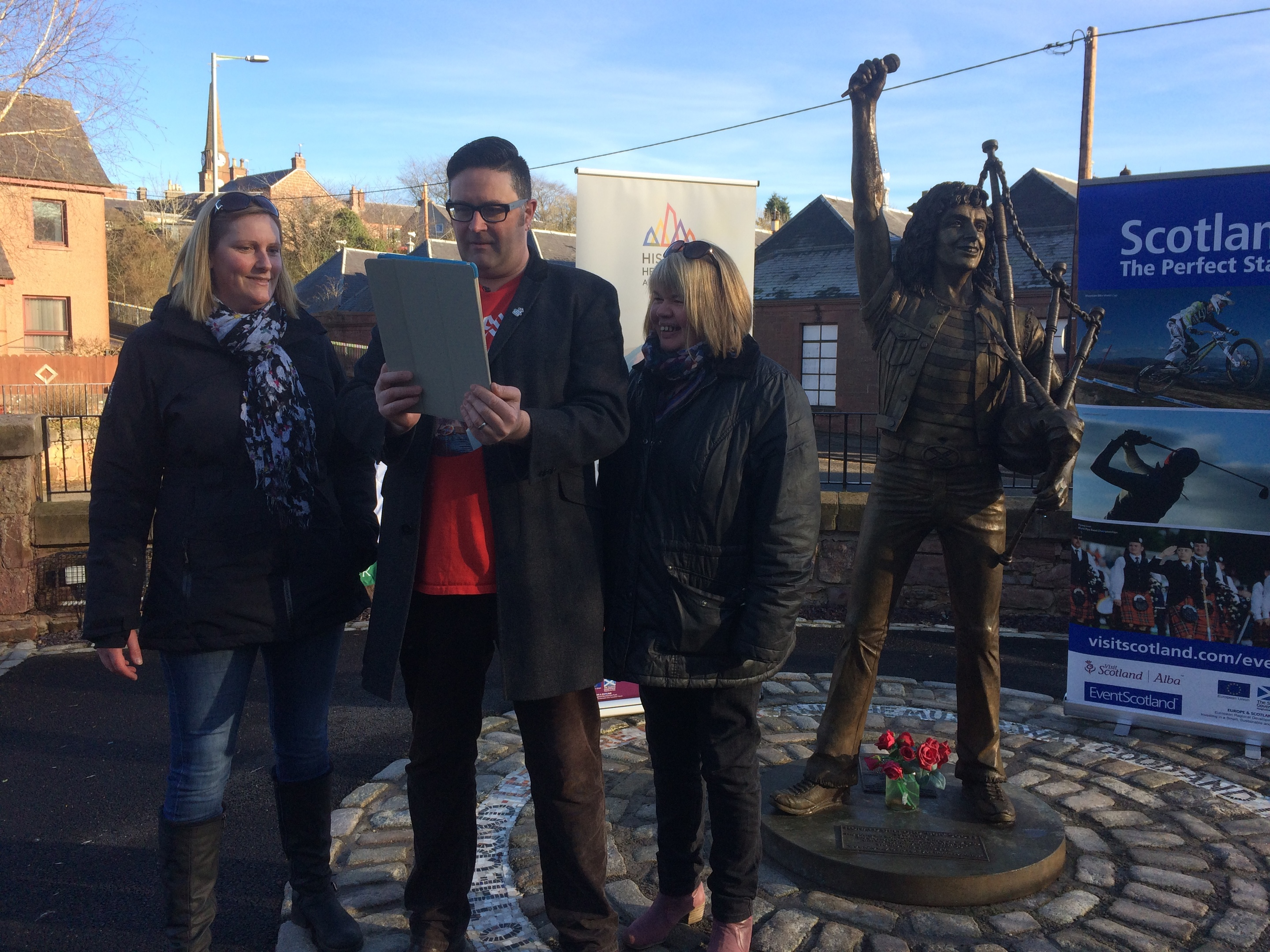 DD8 vice-chair Jayne Grewar, DD8 development worker Graham Galloway and Kirriemuir community council chair Jenni Brown at the Bon statue link-up