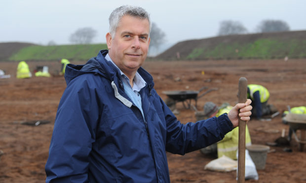 Councillor Boyd at the dig site.