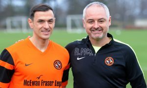 Alex Nicholls with United boss Ray McKinnon.