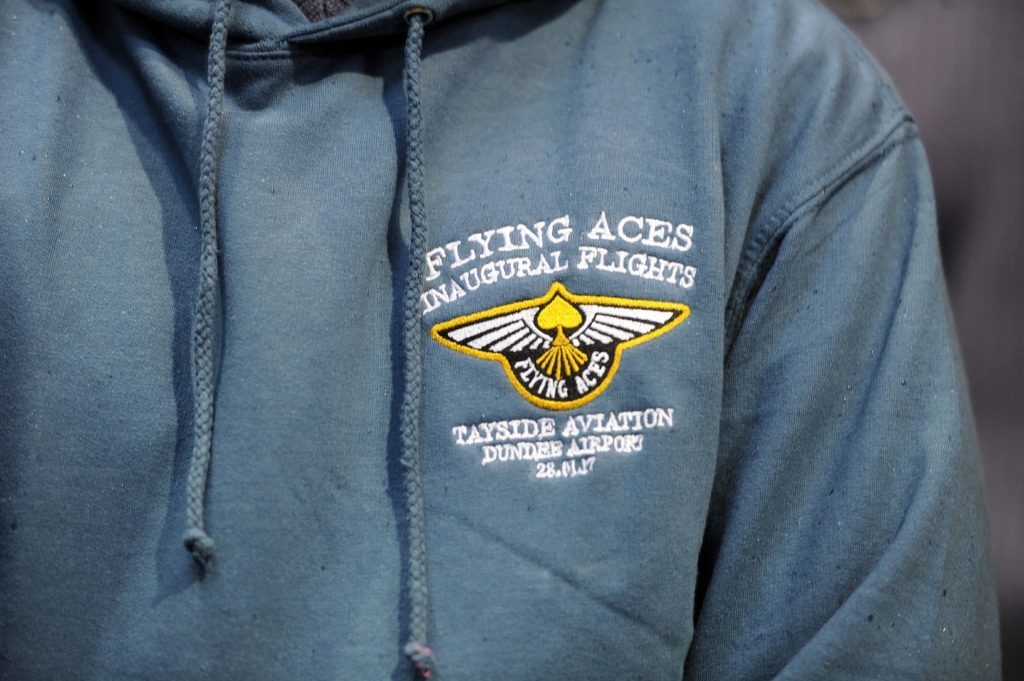 Detail of the Flying Aces logo design on a sweatshirt.