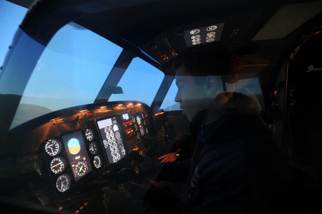 Flying Ace Scott Paddon in the flight simulator.