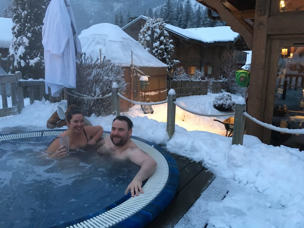 Paul and Louise enjoying their hot tub after a day on the slopes.