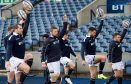 Fraser Brown (left) leads Scotland's warm up in the captain's run at Murrayfield Stadium