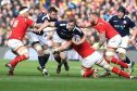 Jonny Gray tries to go through the Welsh defence for Scotland at Murrayfield.