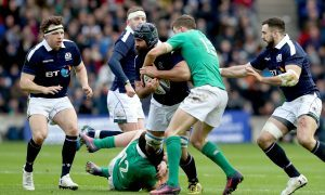 Scotland's Josh Strauss is tackled by Ireland's Garry Ringrose at Murrayfield.