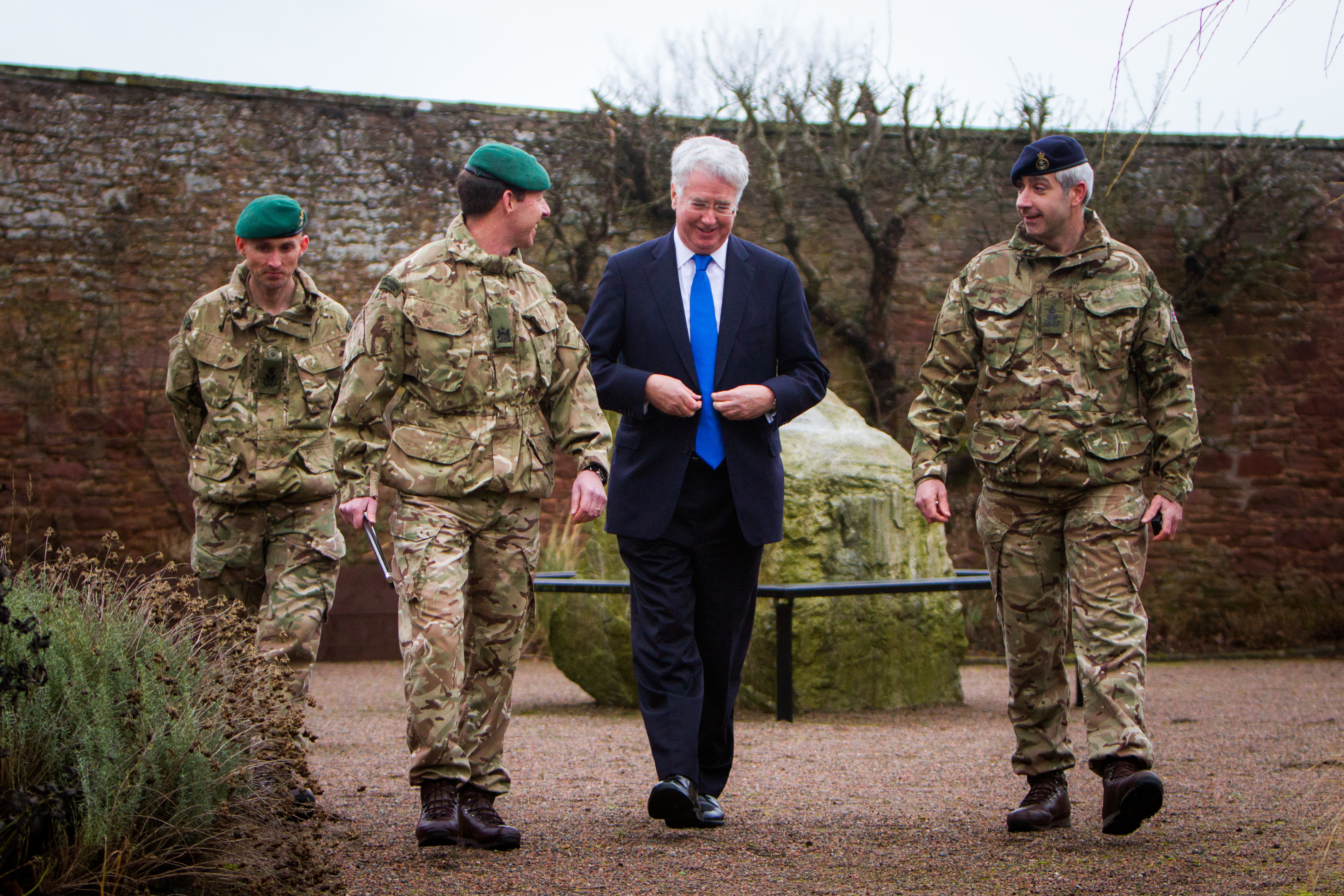 Secretary of State for Defence Sir Michael Fallon alongside PO Jamie Jackson (left), Regimental Lt Sgt Maj WOI Wilson and PO Ian Dixon (right) at RM Condor, Arbroath.