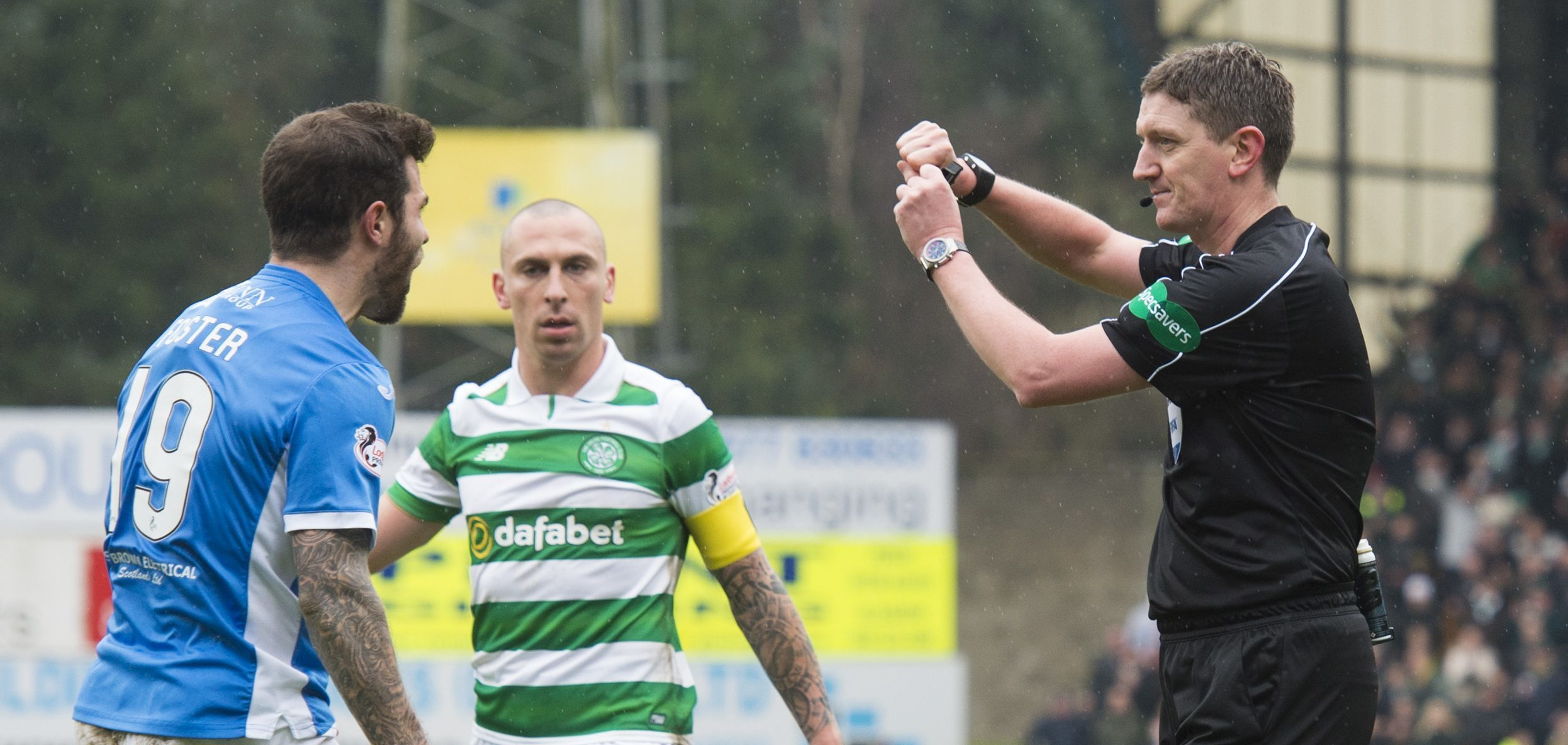 Referee Craig Thomson makes his penalty decision.
