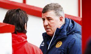 Paul Hartley, left, with Mark McGhee on Saturday at Fir Park.