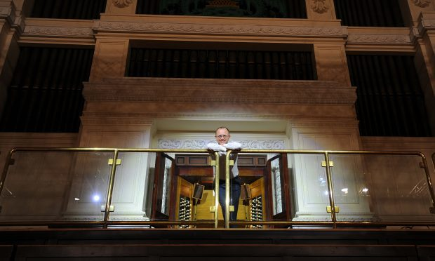 Dundee City organist Stuart Muir in front of the Caird Hall organ.