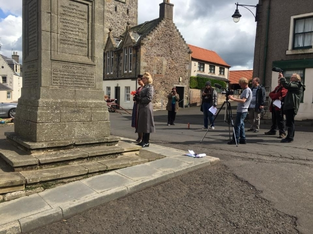 Filming a scene by the war memorial in Auchtermuchty.