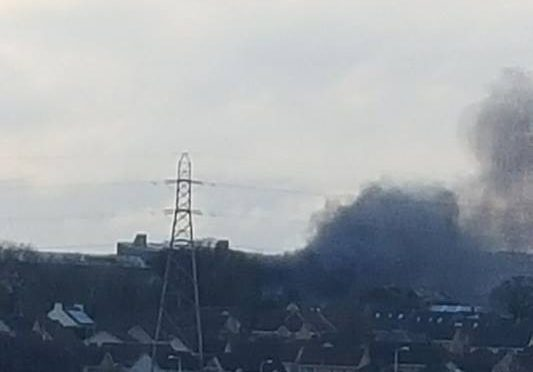 A huge plume of black smoke can be seen coming from South Fod Farm