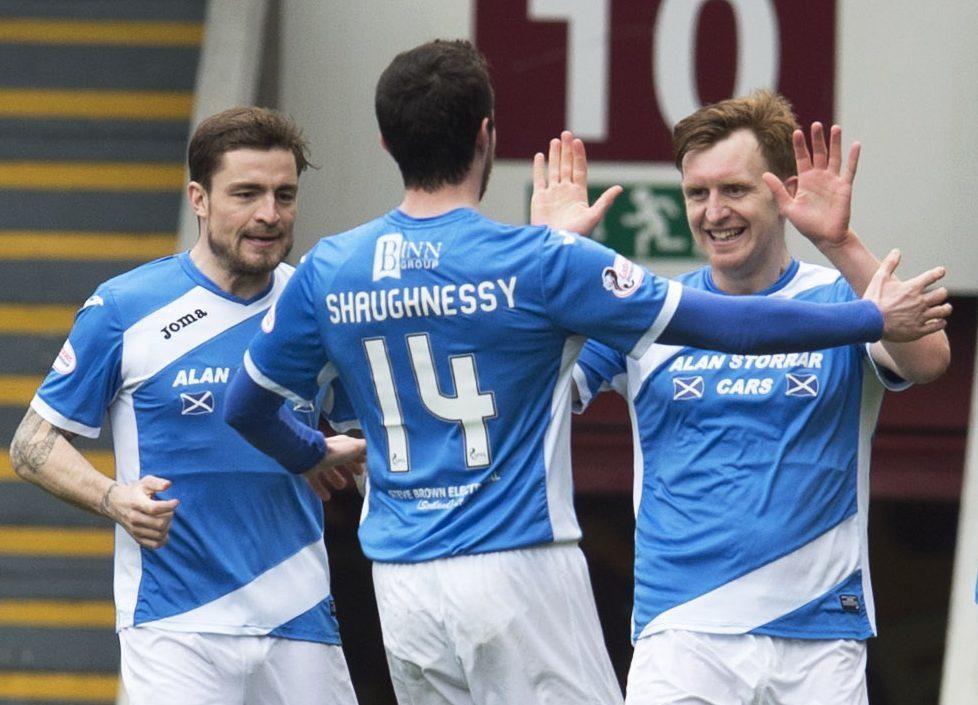 Liam Craig celebrates his first goal with his team-mates.