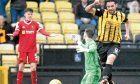 Chris Duggan scores as keeper Ross Stewart and Ross Dunlop can only look on.
