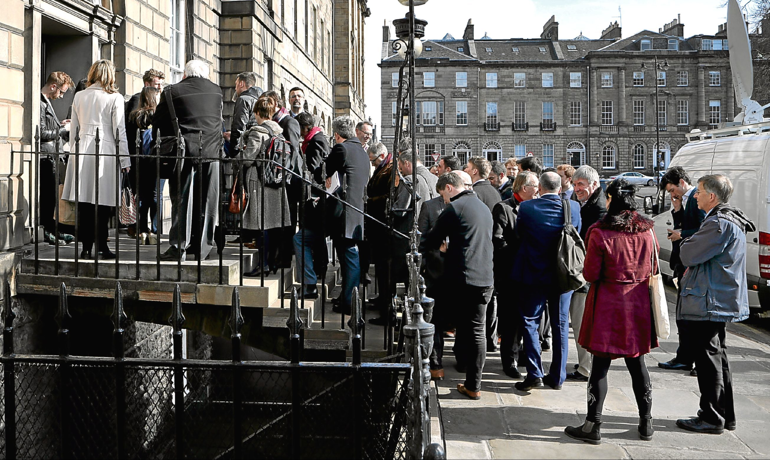"Media wait outside Bute House after Nicola Sturgeon said she will give Scots a ""real choice"" between Brexit and leaving the UK in a second vote on independence."
