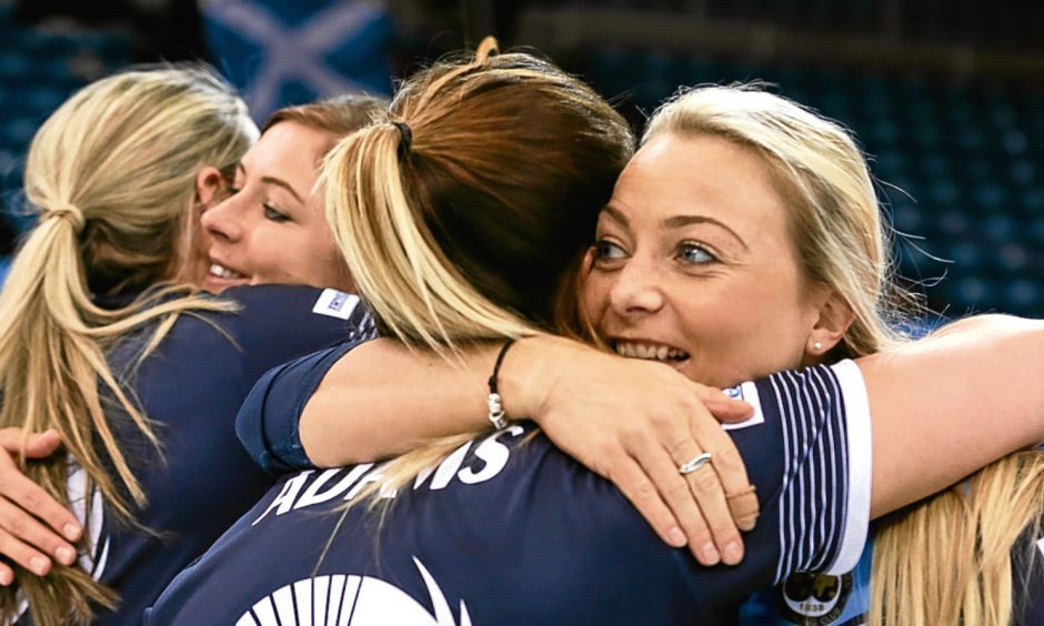 The Scotland women celebrate their victory over Sweden.