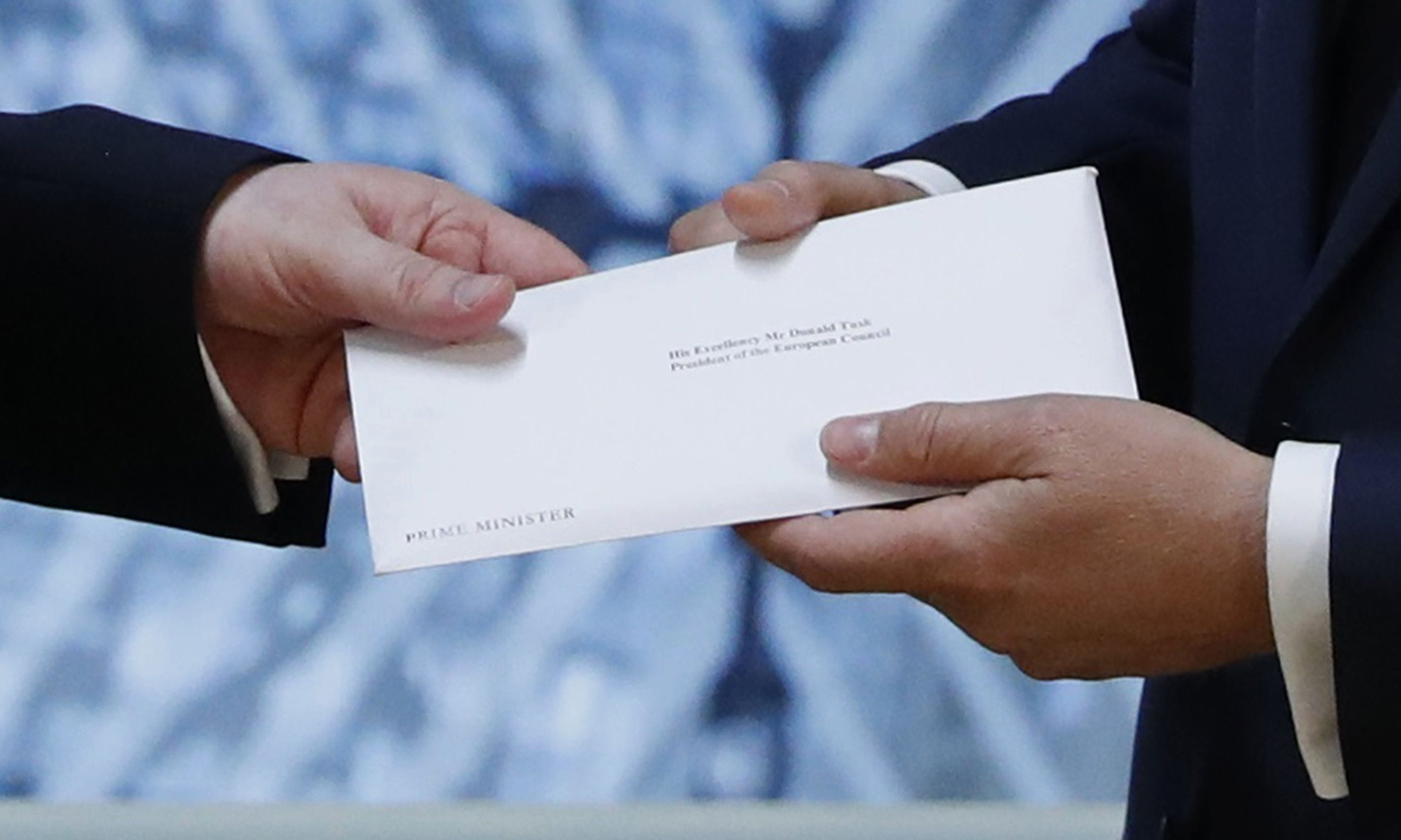 The letter that will formally trigger the beginning of Britain's exit from the European Union is handed over in Brussels.