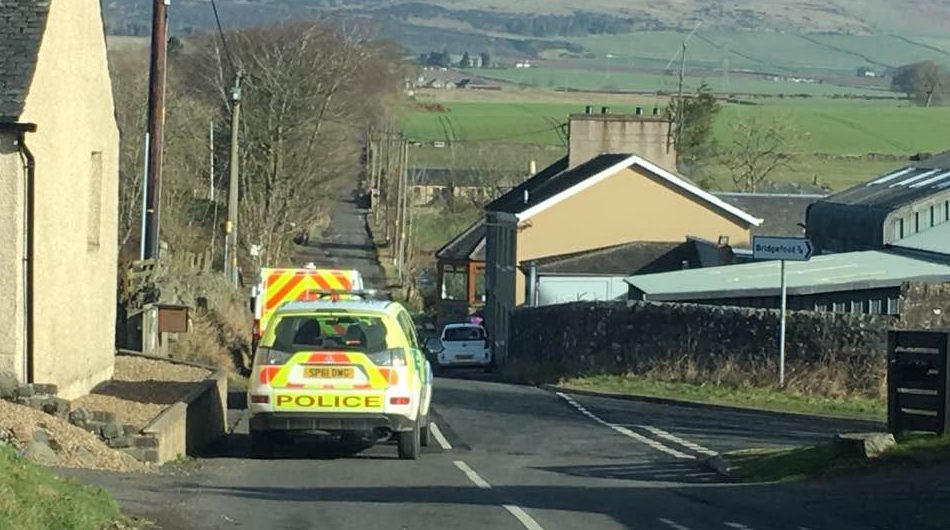 The police vehicles were outside a property in the village.