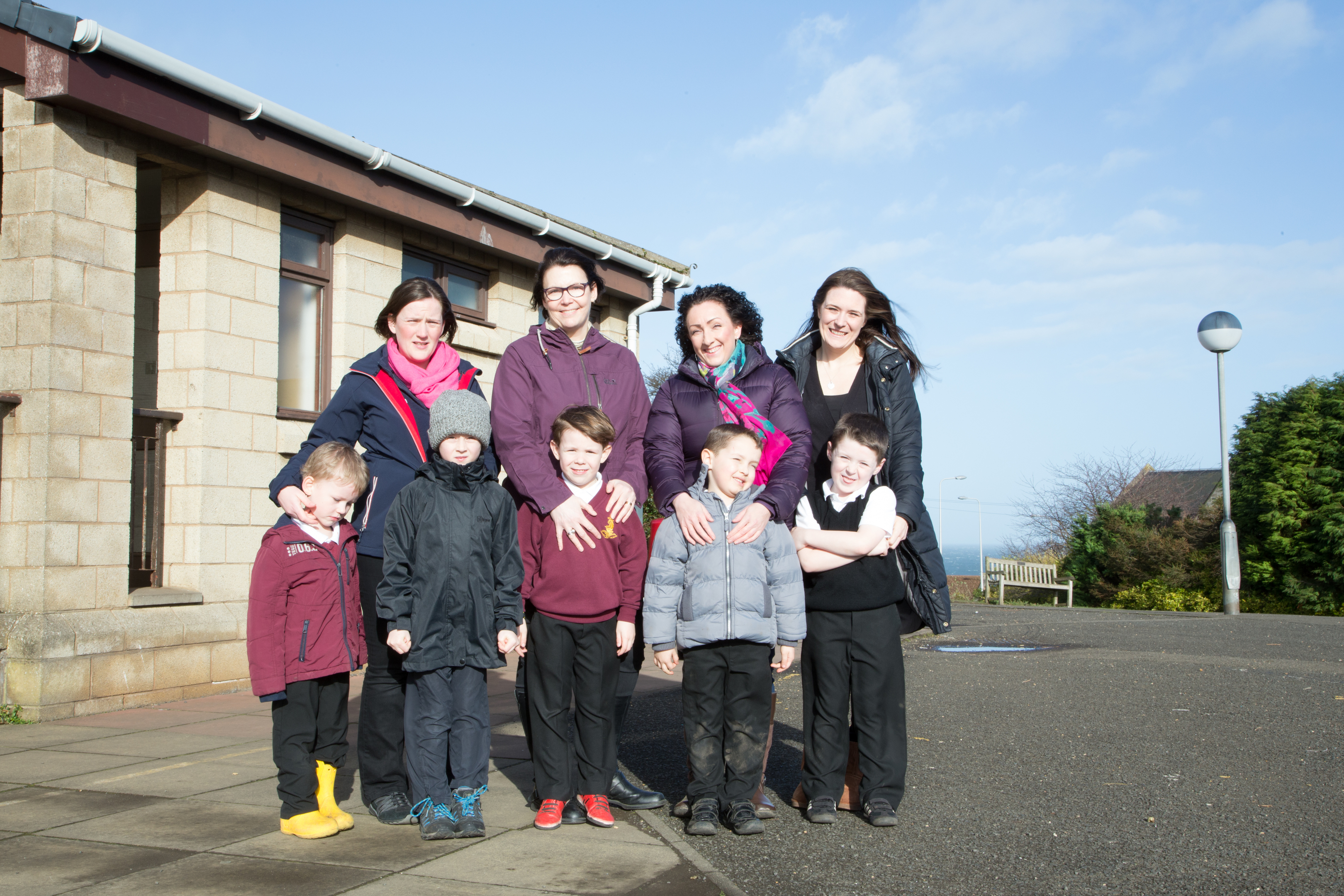Parents stand in the playground. with their children who attend Kinghorn Primary School. L/R Kate Morgan, Patrick Morgan (6), Carol Taylor, Rennie Taylor (6), Mairi Holden, Oscar Holden (5), Gemma Taylor, Bailey Taylor (5) Oliver Taylor (8)