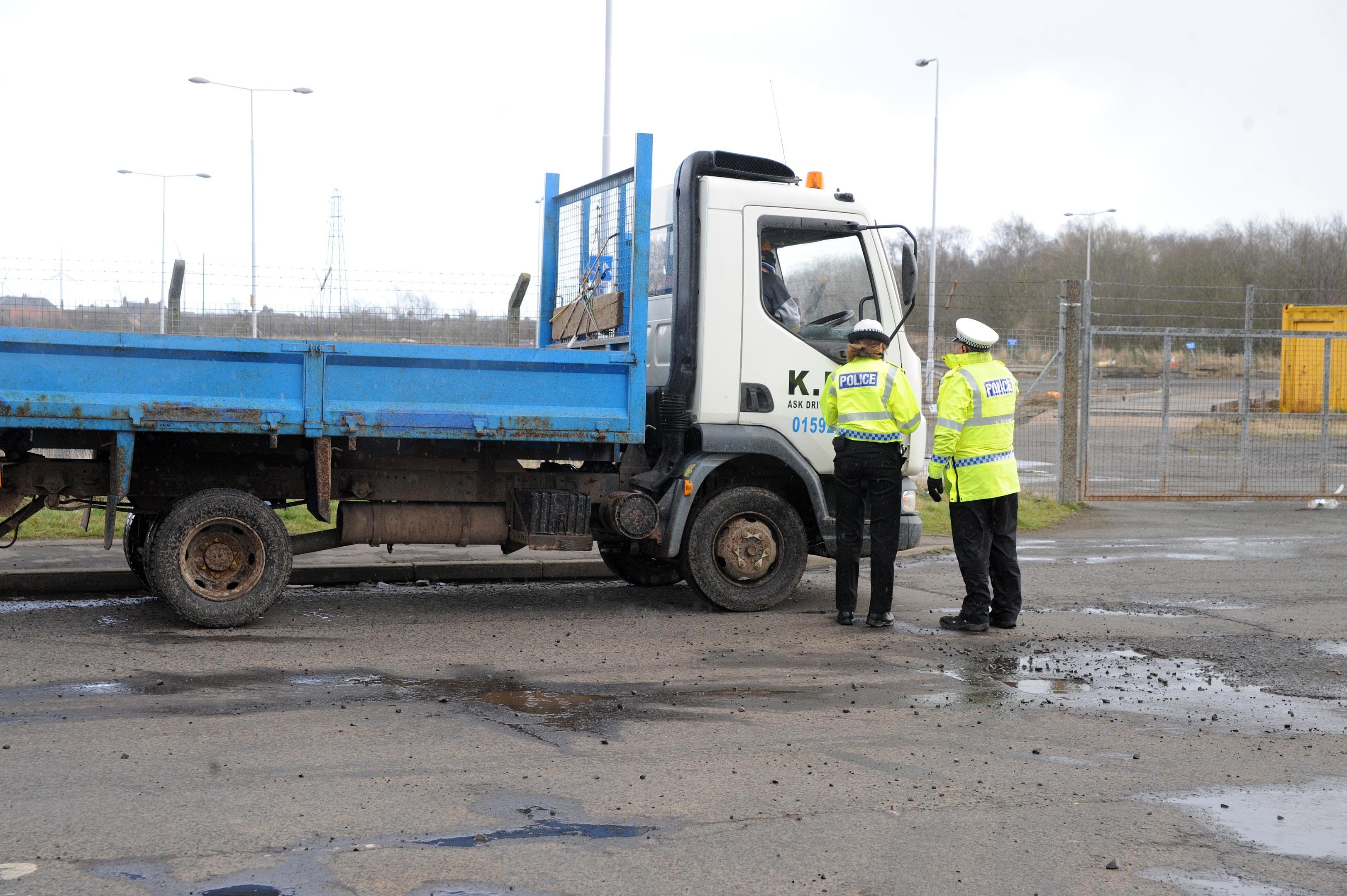 Police check lorries going to scrap metal merchants.