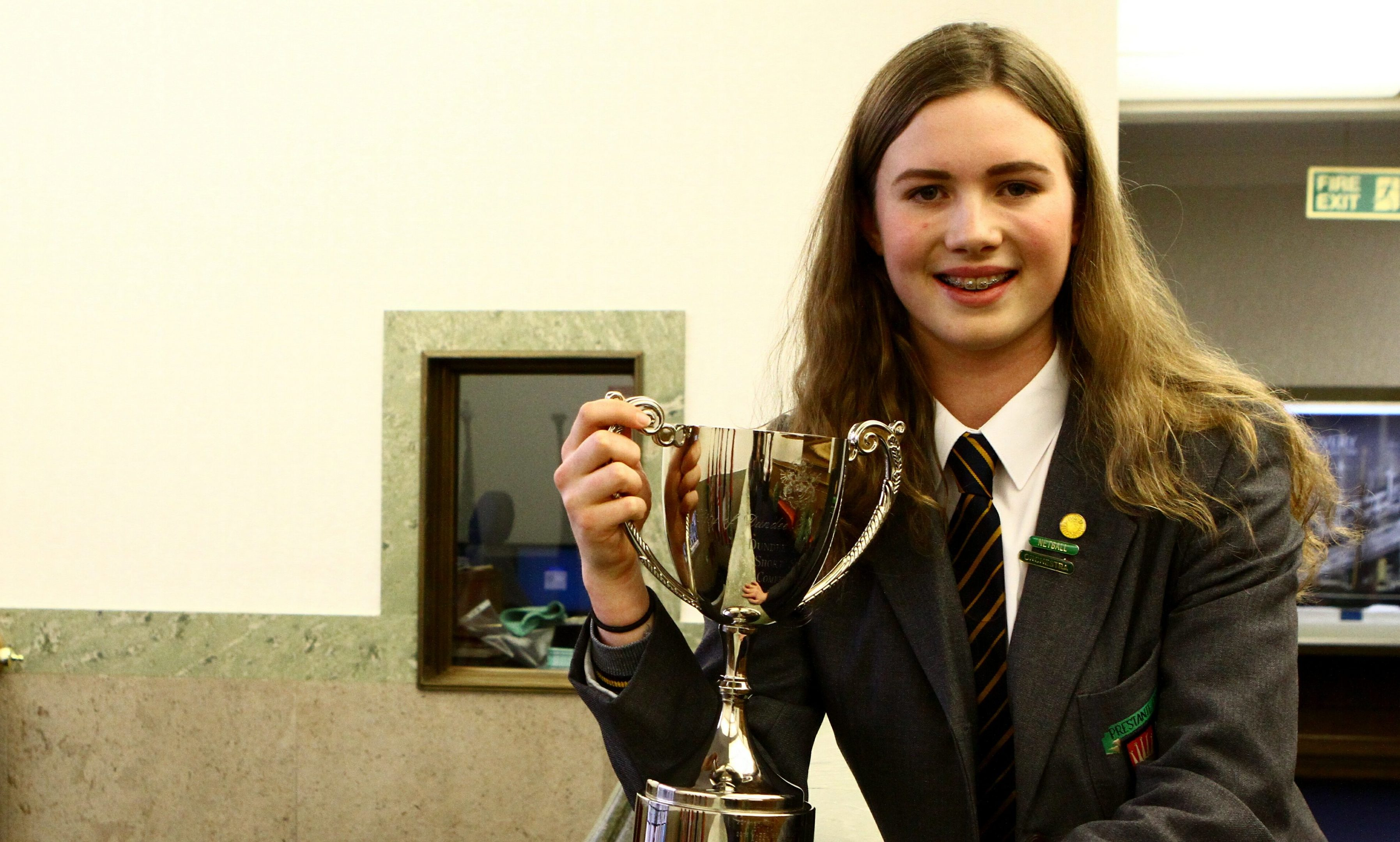 Winner of the Burgess Short Story Competition, Emily Baxter from Dundee High School, with her trophy at the City Chambers in Dundee.