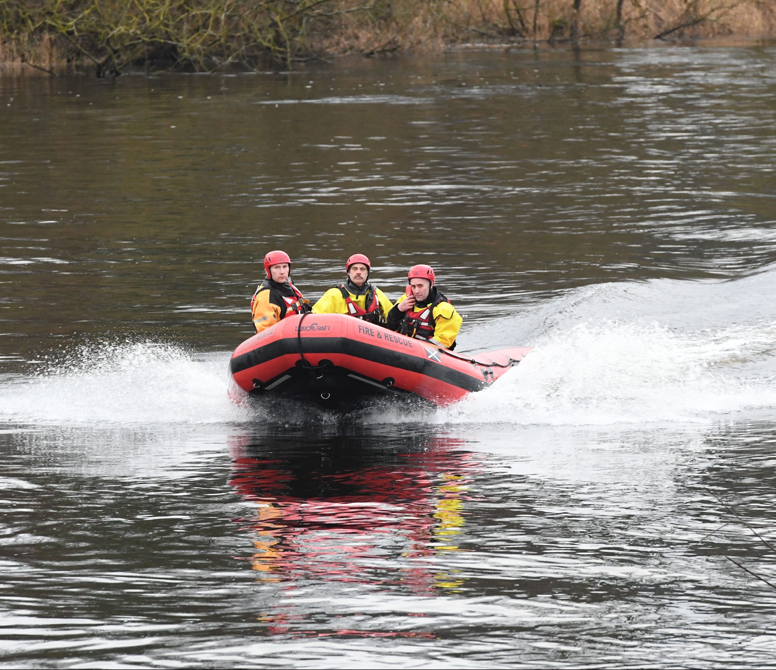 Firefighters search the River Tay, Perth, on Saturday.