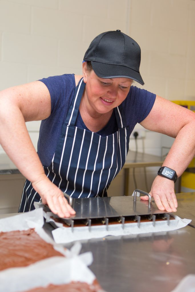 Susan Fleming marking the fudge.