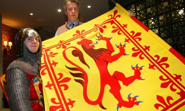 Maxwell Cutting and David Fox Pitt display the new coat of arms.