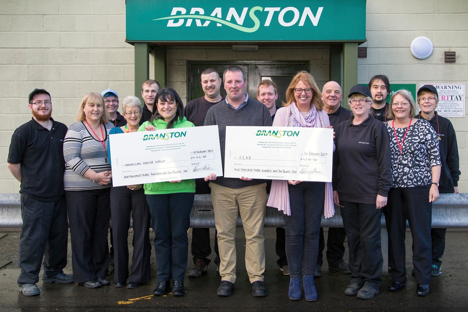 General Manager, Kevin Imrie presenting cheques to Isla Dewar from Macmillan Cancer Support and Fiona Dennis from SCAA.