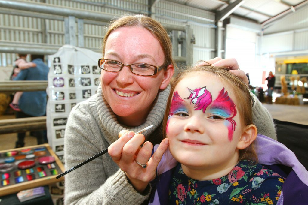 Lauren Whiteside, 4, from Monikie, getting her face painted by Marley Hunter of Put on a Happy Face.